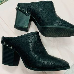 Black heeled mules with silver detailing